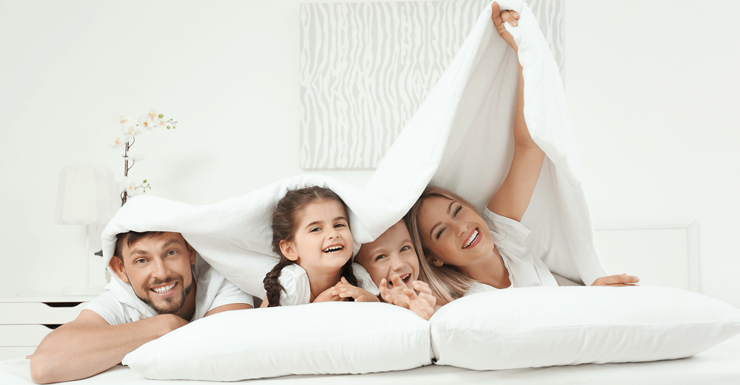 Happy family on vacation under gravity blanket