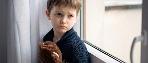 Young Boy Hugging Teddy Bear with Depression